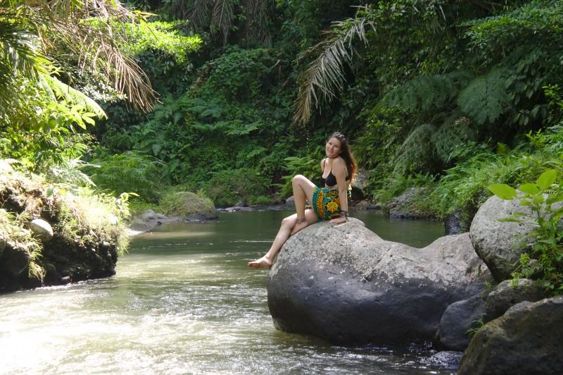 Tina on a rock at Pengempu waterfall