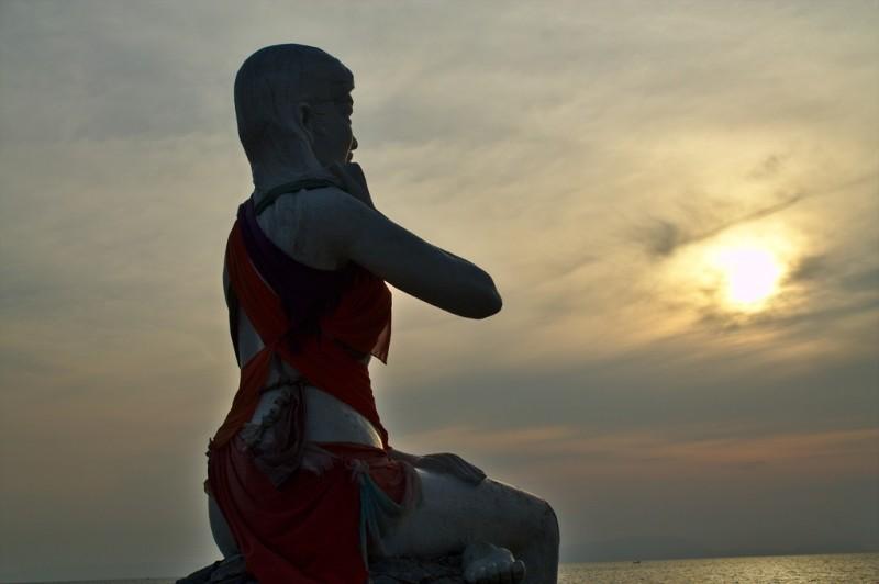 Kep beach dressed statue sunset