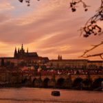 Prague's bridge and castle during sunset