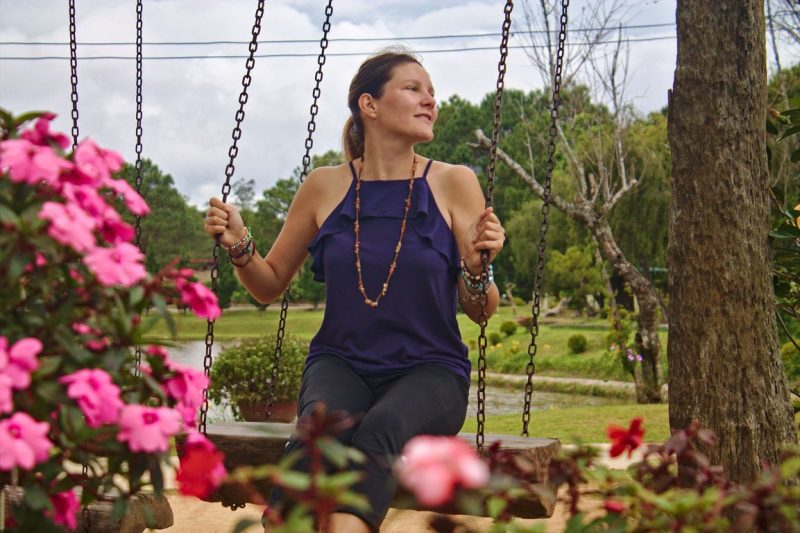 Sitting on the scenic swing at Dalat Flowerpark