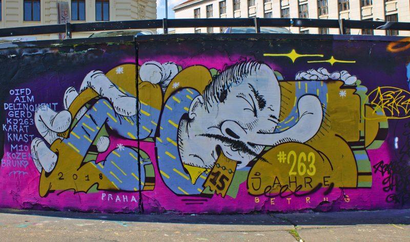 graffity wall, asian, satire, prague, streetart